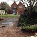 Garden during landscaping with woodland planting, decking and lawn