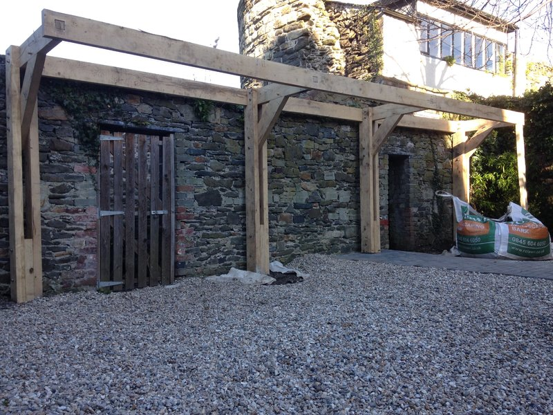 Cantilever Oak pergola in a walled garden