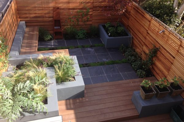 Shirehampton garden outdoor built-in benches, cedar fencing, slate paving and composite decking