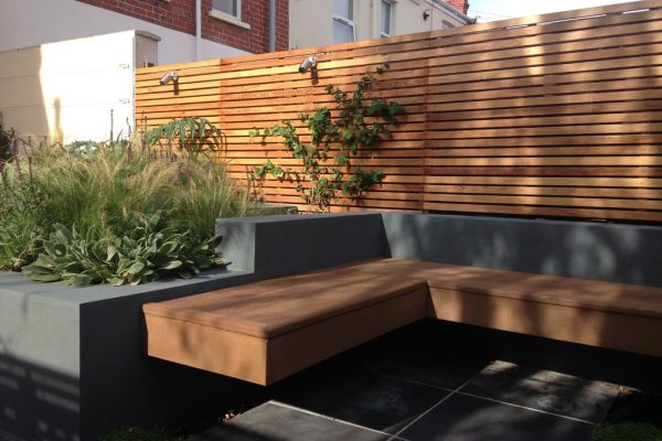 Shirehampton garden with L shaped bench in composite decking