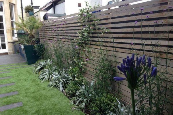 small contemporary family garden henleaze iron butterfly design