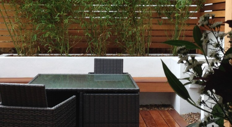 small urban garden with built-in beds, bench and daybed with modular outdoor table and seats