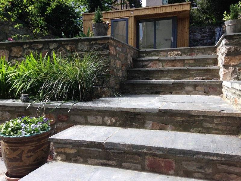 Terraced garden with slate steps and raised beds