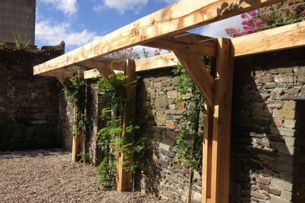Cantilever Oak pergola in walled garden
