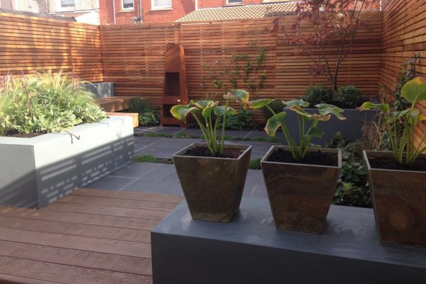 Shirehampton garden with plinth and hosta planters