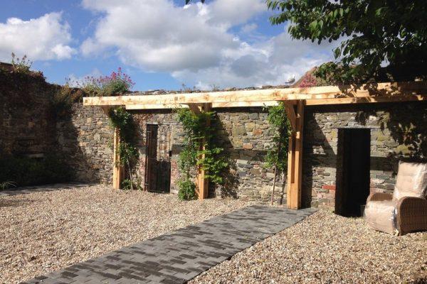 Cantilever Oak pergola in walled garden